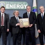 Secretary Moniz presented the 2015 DOE Secretarial Honor Awards to the ACME Executive Committee, pictured here during a special program held May 8 at DOE headquarters in Washington, D.C. From left to right: Mark Taylor, Secretary Moniz, David Bader, and Bill Collins.