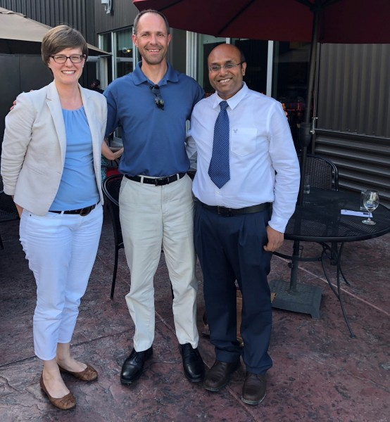 Ian Kraucunas, center, with Pacific Northwest National Laboratory atmospheric science colleagues and DOE Early Career Award winners Susannah Burrows, left, and Manish Shrivastava, right.