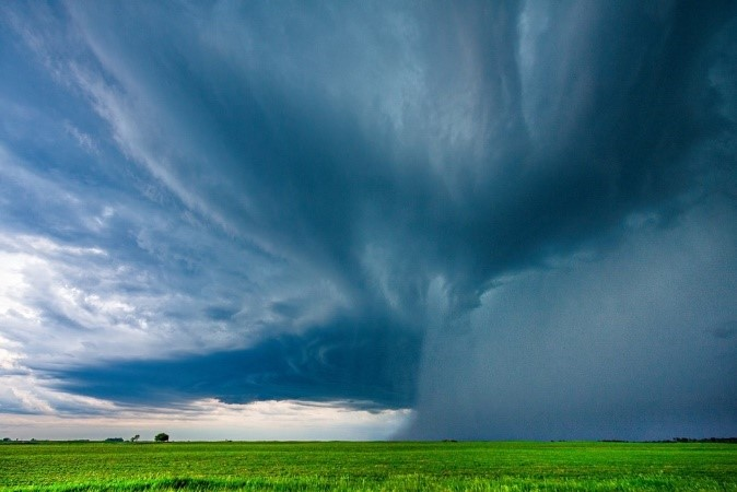 A severe summertime convective storm unleashes rain over farmland in Oklahoma. Surface heat pushes moisture higher in the atmosphere, creating potentially damaging thunderstorms. Photo by Zhe Feng, Pacific Northwest National Laboratory.