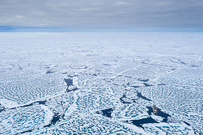 An aerial view of the summertime Arctic Ocean, and the German research icebreaker R/V Polarstern. It was taken during the waning days of the 2019-2020 Multidisciplinary drifting Observatory for the Study of the Arctic Climate (MOSAiC) field campaign―already the source of unique data that will inform regional models of the Earth's high latitudes.