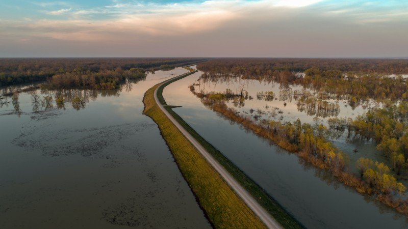 Floods that overwhelm farm fields and built infrastructure elsewhere are one potential consequence of severe storms. Photo by Justin Wilkens, Unsplash.